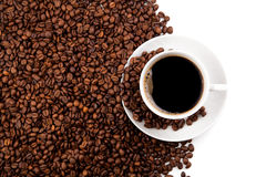 Cup of black coffee. And roasted coffe beans on a white background Stock Image