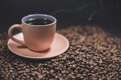 Cup of black coffee and roasted coffee beans. royalty free stock photos