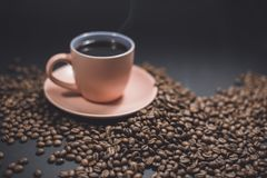 Cup of black coffee and roasted coffee beans. royalty free stock photography