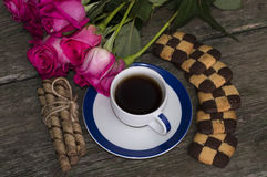Cup of black coffee of a rose and cookies the top view Stock Photos