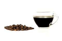 Black coffee and beans. Cup of black coffee and some coffee beans  on white Royalty Free Stock Image