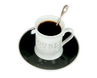 Cup of black coffee with the spoon. Isolated on white Royalty Free Stock Photography
