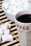 Cup of black coffee and Sugar Royalty Free Stock Image