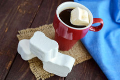 A cup of black coffee  and sweet marshmallow on a dark wooden background. Royalty Free Stock Photography