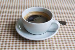 Cup of black coffee on table Stock Image