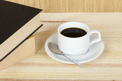 Cup of black coffee on table with reading books Royalty Free Stock Photos