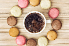 Cup of black coffee with tasty french colorful macarons, view fr Royalty Free Stock Image
