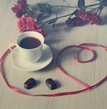 Cup of black coffee with two sweets and flowers Royalty Free Stock Photo