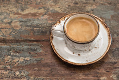 Cup of black coffee on wooden table Stock Photos