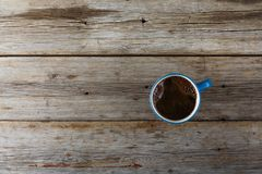 A cup of black coffee on a wooden table. View from above. Texture Royalty Free Stock Photos