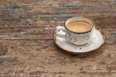 Cup of black coffee on wooden table. Vintage style Royalty Free Stock Photo