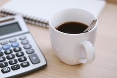 A cup of black coffee on working desk. A cup of black coffee on accountant working desk Stock Images