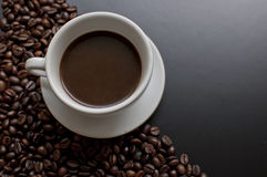 Cup of black hot coffe. On the black background. Black and white photo Stock Images