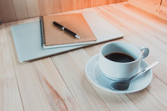 Cup of black hot coffec put near digital notebook Stock Photo