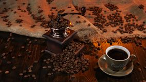 Cup black hot coffee and beans scattered on the table stock video footage