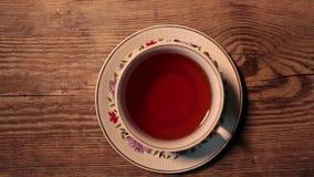 Cup of black hot tea. Hot black tea on table overhead shot stock video footage