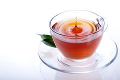 A cup of black tea. On a white background Royalty Free Stock Photo