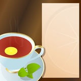Cup of black tea. Hot cup of black tea, with lemon, green leaves and notepad for descriptions beside it Stock Images