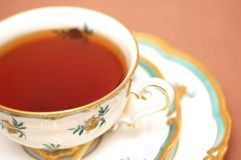 Cup of black tea on biege back Royalty Free Stock Image