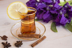 Cup of black tea and blue iris flowers Stock Images