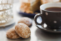 Cup with black tea and cakes Stock Images