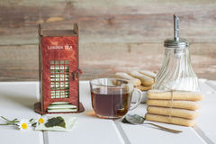 A cup of black tea. Cookies and gift box royalty free stock photography