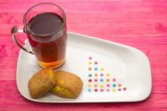 Cup black tea and  cookies with lemon cream Royalty Free Stock Images