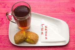 Cup black tea and  cookies with lemon cream Stock Images