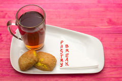 Cup black tea and  cookies with lemon cream Stock Photography