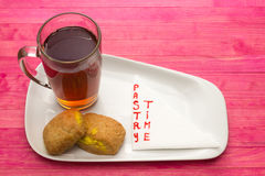 Cup black tea and  cookies with lemon cream Royalty Free Stock Photo