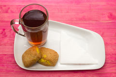 Cup black tea and  cookies with lemon cream Royalty Free Stock Photography