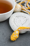 Cup of black tea and crocheted pebbles Royalty Free Stock Photography