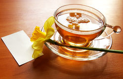 Cup of black tea and  flowers Royalty Free Stock Image