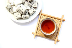 A cup of black tea and fruit Royalty Free Stock Photos