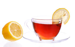 A cup of black tea with lemon. Transparent cup with black tea with a lemon Royalty Free Stock Photo