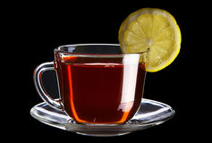 Cup of black tea with lemon Stock Photos