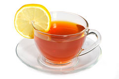 Cup with black tea and lemon Royalty Free Stock Images