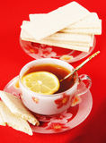Cup of black tea with a lemon Royalty Free Stock Photo