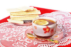 Cup of black tea with a lemon Royalty Free Stock Photos