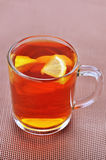 Cup of black tea with lemon Stock Image