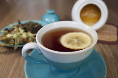 Cup of black tea with lemon. Tea leaves and honey, tea party, tea time, still-life Stock Photo