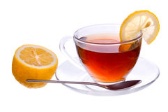 A cup of black tea with lemon and spoon Royalty Free Stock Photos