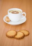 Cup of black tea with lemon, sugar and biscuits royalty free stock photography