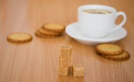 Cup of black tea with lemon, sugar and biscuits Stock Photography