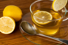 Cup of black tea with lemon on wood desk Stock Photography