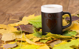 Cup of black tea with love inscription Stock Photos