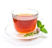 Cup of black tea with mint leaves and flower Stock Photography
