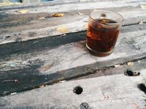 Cup of black tea on an old wooden table Stock Photography