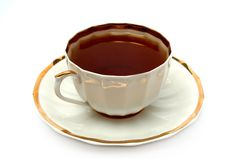 Cup of black tea on a plate Stock Images