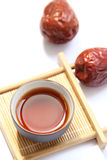 A cup of black tea with red dates Royalty Free Stock Photography